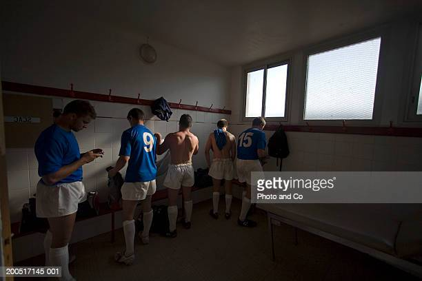 rugby players changing in dressing room - rugby team stock pictures, royalty-free photos & images