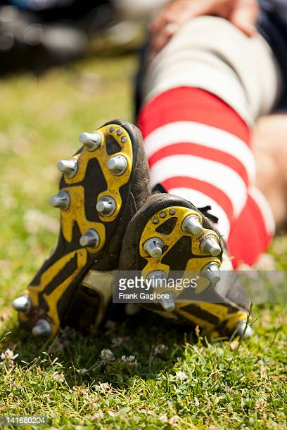 Rugby players cleats.