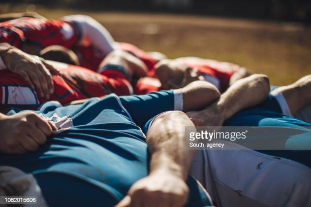 rugby players during game - rugby stock pictures, royalty-free photos & images