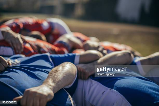 rugby players embracing - rugby stock pictures, royalty-free photos & images