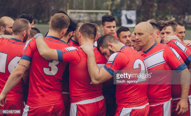 rugby players huddling during time out - rugby team stock pictures, royalty-free photos & images
