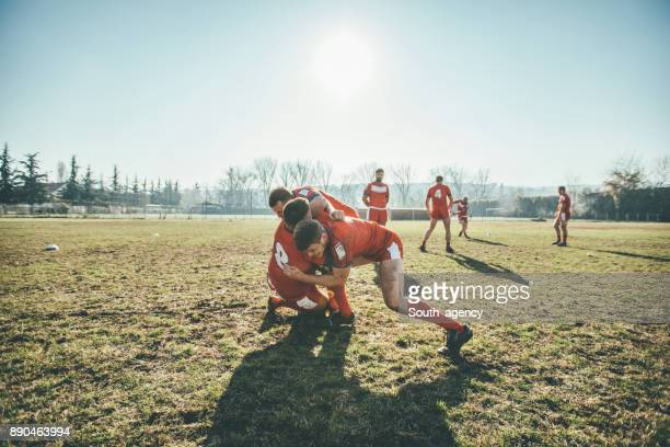 rugby players in action - tackling stock photos and pictures