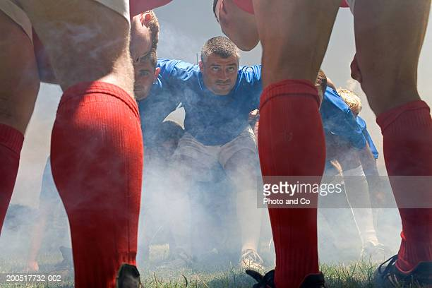 Rugby players in scrum, low angle view