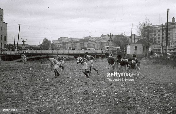 Rugby players in training at a reclaimed ground near the Gofukubashi Bridge in Nihombashi area on November 10 1948 in Tokyo Japan
