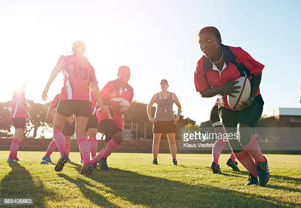 rugby players practicing in the field - pink sock image stock pictures, royalty-free photos & images