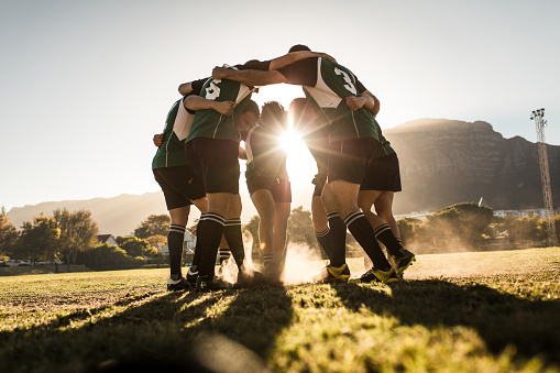 Rugby players rejoicing victory 1095014750