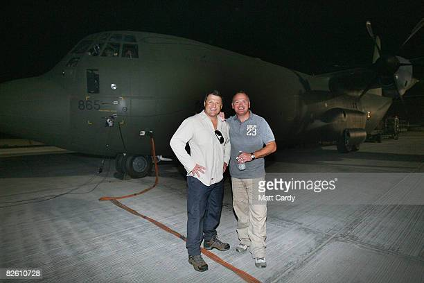 Rugby players Scott Gibbs and Ieuan Evans pose in front of a RAF Hercules at Al Udeid Air Base on August 25 2008 in Qatar The two retired Welsh...