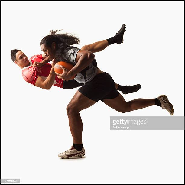 rugby players tackling for ball - tackling stock pictures, royalty-free photos & images