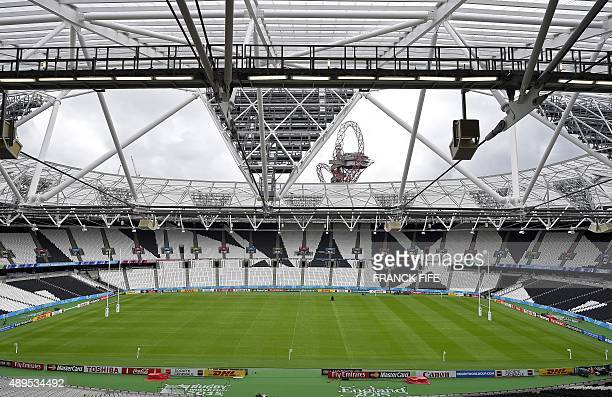 Rugby posts stand at either end of the pitch inside the Olympic Stadium in London on September 22 on the eve of France's 2015 Rugby Union World Cup...
