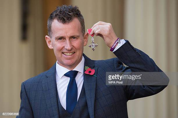Rugby referee Nigel Owens with his MBE which he received from the Duke of Cambridge at Buckingham Palace on November 11 2016 in London England