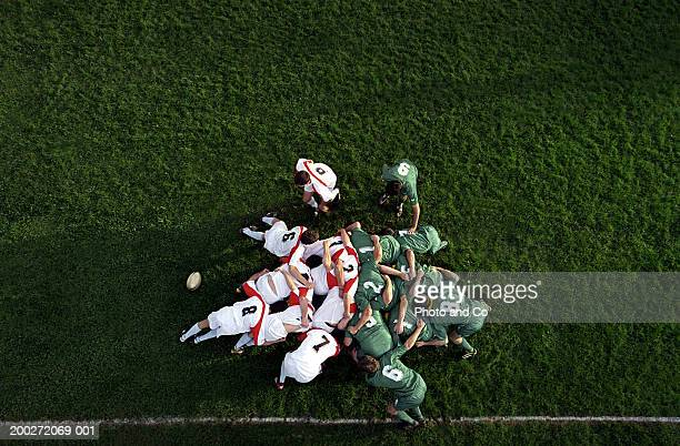 rugby scrummage, overhead view - rugby team stock pictures, royalty-free photos & images