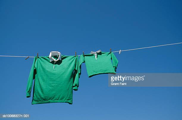 rugby shirts drying on string - sports jersey stock pictures, royalty-free photos & images