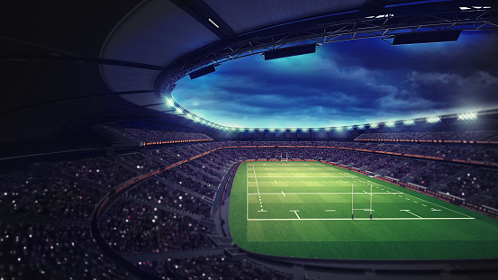 rugby stadium with fans under roof with spotlights 1056806790