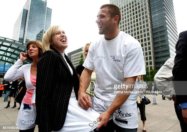 Rugby star Ben Cohen signs an autograph for a fan during the annual Men In Pants walk in aid of male cancer charity Orchid in London