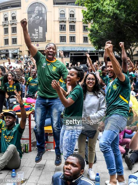 Rugby supporters celebrate as they watch the Rugby World Cup 2019 final match between England and South Africa at Nelson Mandela Square on November...