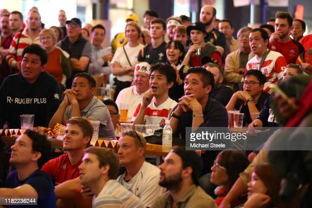 Rugby supporters watch the Japan versus South Africa quarterfinal match outside the main railway staionon October 20 2019 in Oita Japan