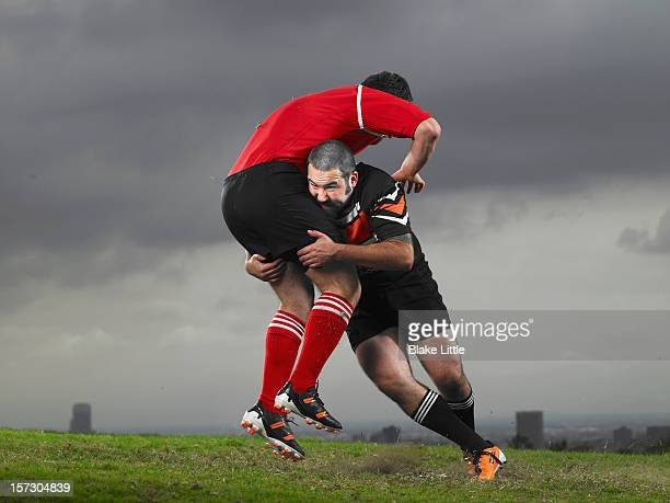 rugby tackle. - tackling stock pictures, royalty-free photos & images