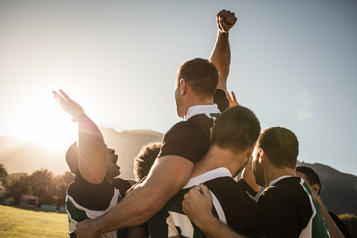 Rugby team celebrating the victory 1031499956