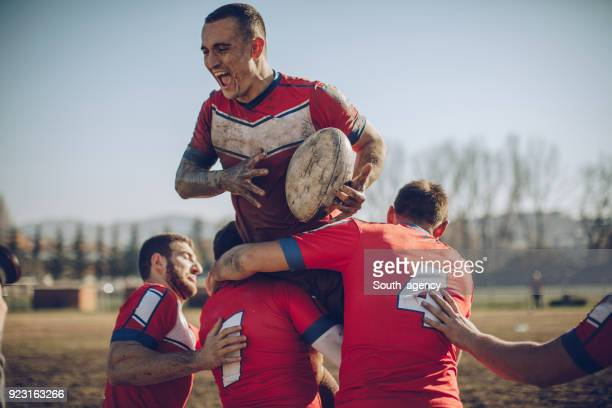 rugby team celebrating victory - rugby team stock pictures, royalty-free photos & images