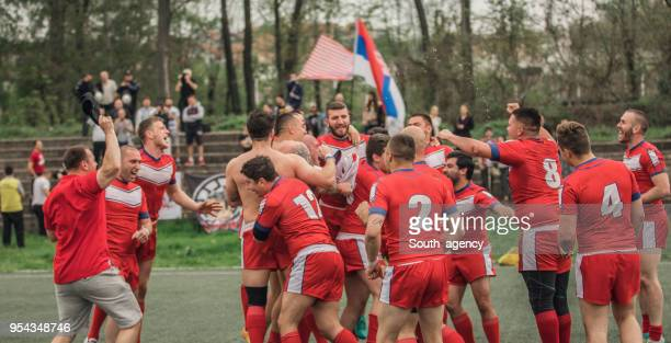 rugby team celebrating victory - rugby league stock pictures, royalty-free photos & images