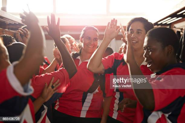 rugby team doing high fives after game - rugby team stock pictures, royalty-free photos & images