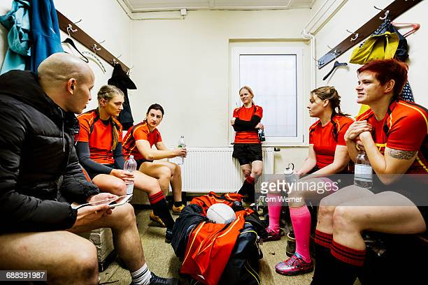 rugby team having a break in the locker room - locker room stock pictures, royalty-free photos & images