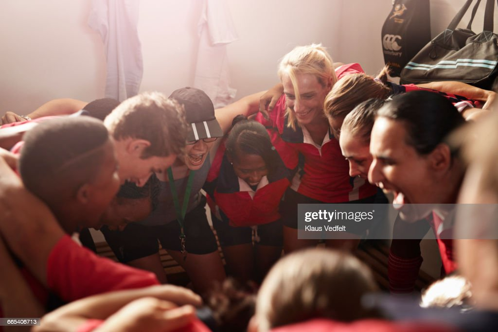 Rugby team shouting together before game : Stock Photo