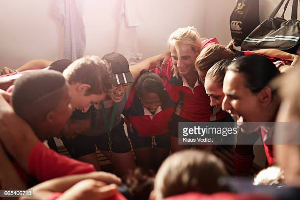 rugby team shouting together before game - coach stock pictures, royalty-free photos & images