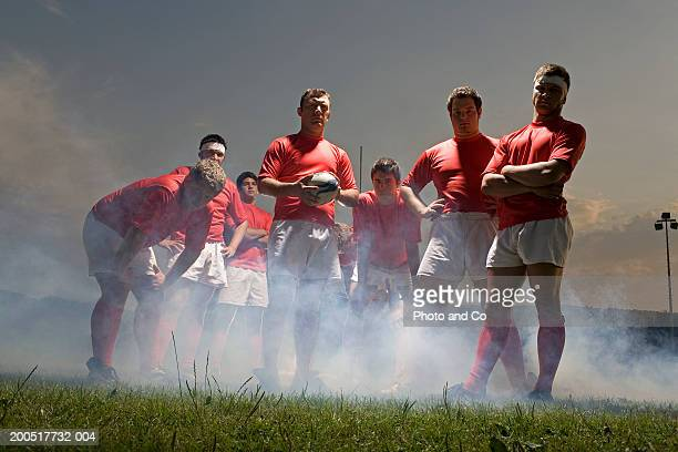rugby team standing in mist on pitch, low angle view - rugby team stock pictures, royalty-free photos & images