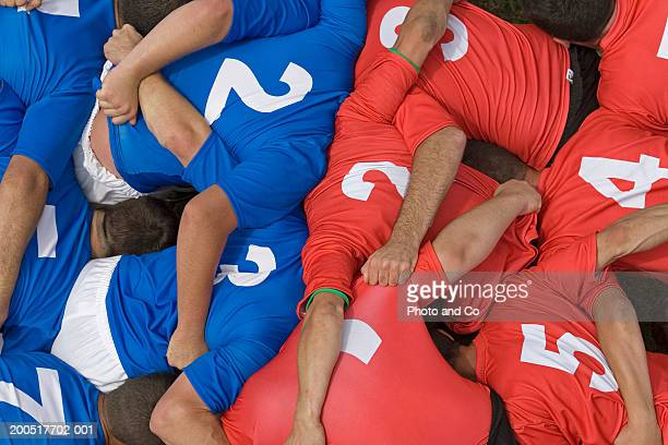 rugby teams in scrum, overhead view - scrum stock pictures, royalty-free photos & images
