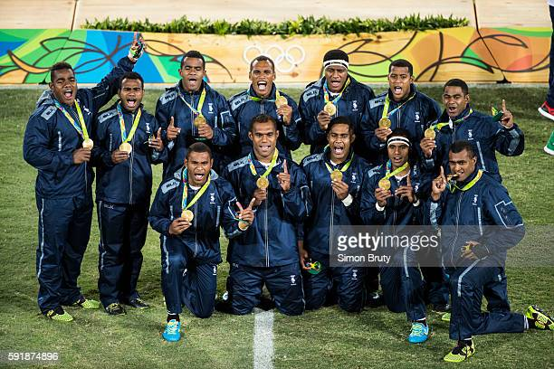 2016 Summer Olympics Group photo of Team Fjii posing with their gold medals at medal ceremony after Fiji vs Great Britain Men's Sevens Final at...