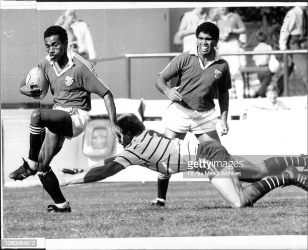 Rugby Union Grand Final at Concord Oval Randwick Vs WarringahRandwick's Glen Ella watches in the background as winger Acura Niuqila steps away from a...