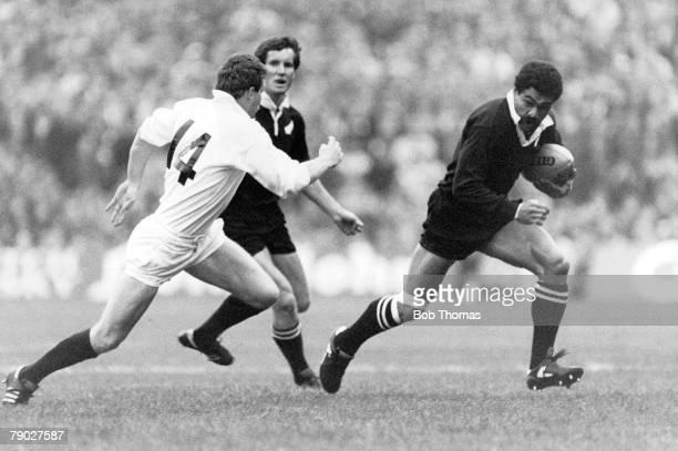 Rugby Union International 12th November 1983 Murrayfield Scotland 25 v New Zealand 25 New Zealand's Bernie Fraser is pursued by Scotland's Jim...