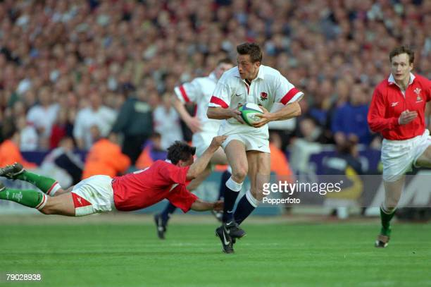 Rugby Union International Wembley 11th April Wales 32 v England 31 England wing Dan Luger faces a flying tackle from Welsh full back Shane Howarth