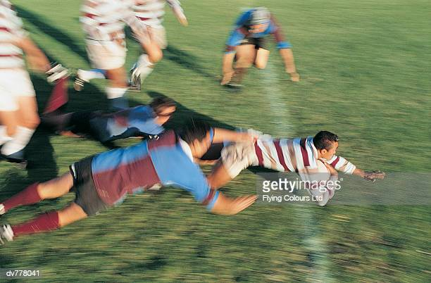 rugby union player about to score for his team - rugby field stock pictures, royalty-free photos & images