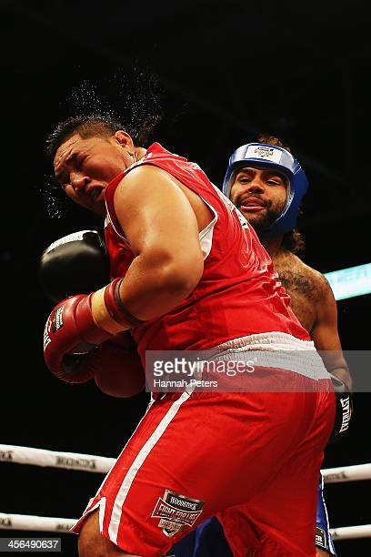 Rugby Union player Ben Tameifuna fights rugby league player Sam Thaiday during 'Fight for Life' at The Trusts Stadium on December 14 2013 in Auckland...