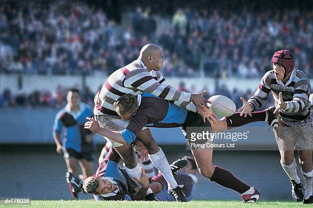 Rugby Union Player Passing The Ball Whilst Being Tackled