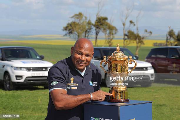 Rugby World Cup 1995 winner Chester Williams takes the Webb Ellis Cup during Land Rovers Least Driven Path to Protem school children during the Rugby...