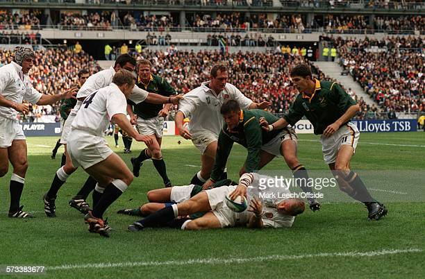 Rugby World Cup 1999 Quarter-Final, England v South Africa, Lawrence Dallaglio is supported by team-mates at Stade de France.