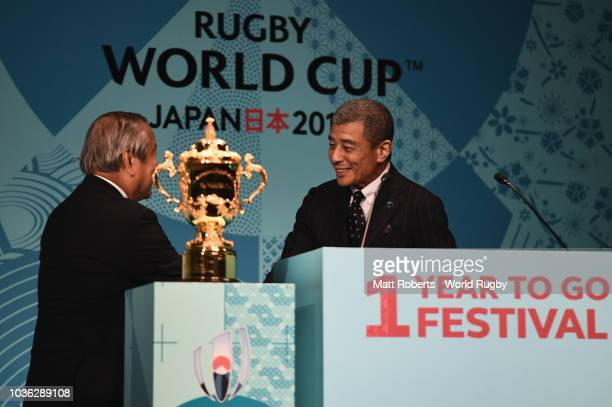 Rugby World cup 2019 organsng committee CEO Akira Shimazu and Japanese actor Hirosh Tachi shake hands on stage during the Rugby World Cup One Year To...