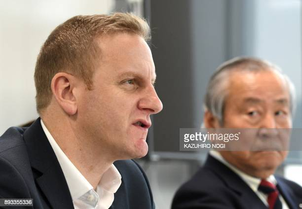 Rugby World Cup Tournament Director Alan Gilpin speaks during a press briefing in Tokyo on December 15 2017 while Rugby World Cup 2019 Organising...