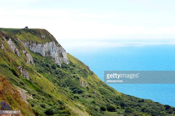 rugged clifftop at nothe  point, osmington mills, ringstead bay, jurassic coast, dorset, england - weymouth dorset stock pictures, royalty-free photos & images