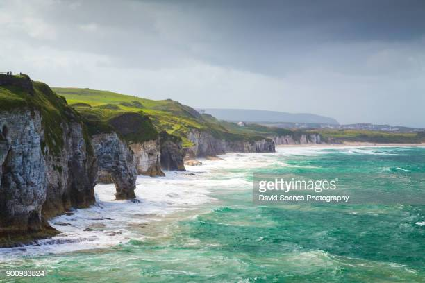 a rugged coastal landscape along the causeway coast in antrim, northern ireland - county antrim stock pictures, royalty-free photos & images