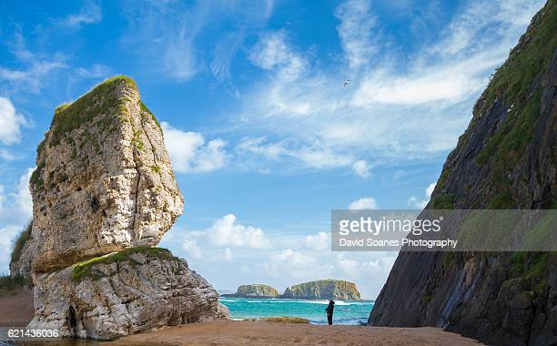 a rugged coastal landscape at ballintoy harbour along the causeway coast in antrim, northern ireland - county antrim stock pictures, royalty-free photos & images