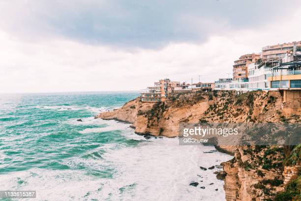 rugged coastline of beirut lebanon - beirut stock pictures, royalty-free photos & images
