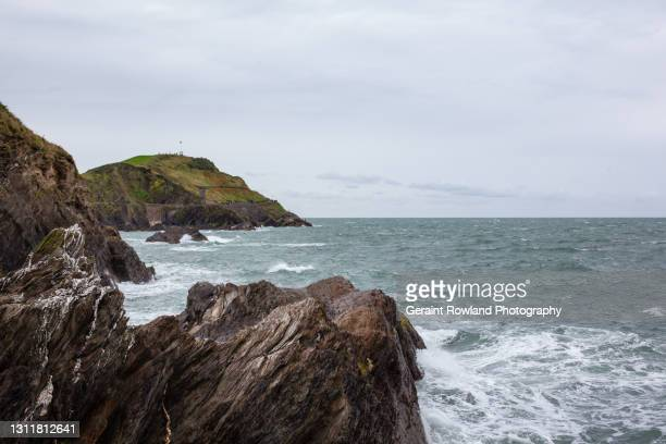 rugged coastline of devon, england - geraint rowland stock pictures, royalty-free photos & images