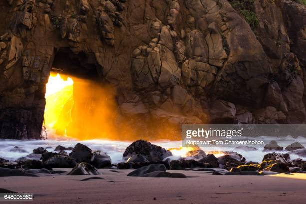 rugged keyhole rock arch at pfeiffer beach, ca, usa - big sur stock photos and pictures