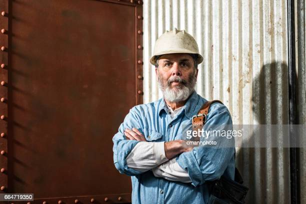 Rugged looking Middle-aged construction worker on job site