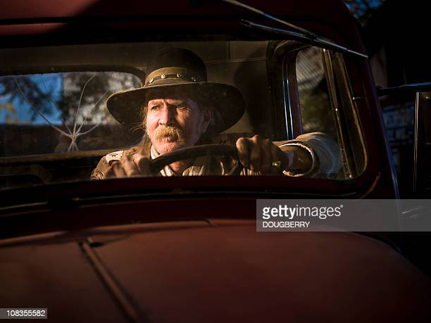 rugged man sitting in old truck - old truck stock pictures, royalty-free photos & images