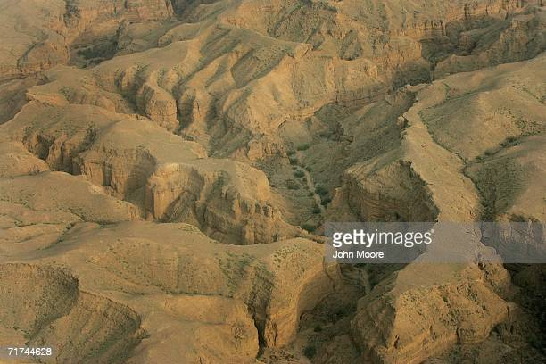 Rugged ravines etch the landscape where the Pakistani army says that the body of Baloch rebel leader Nawab Akbar Bugti lies beneath rubble in the...